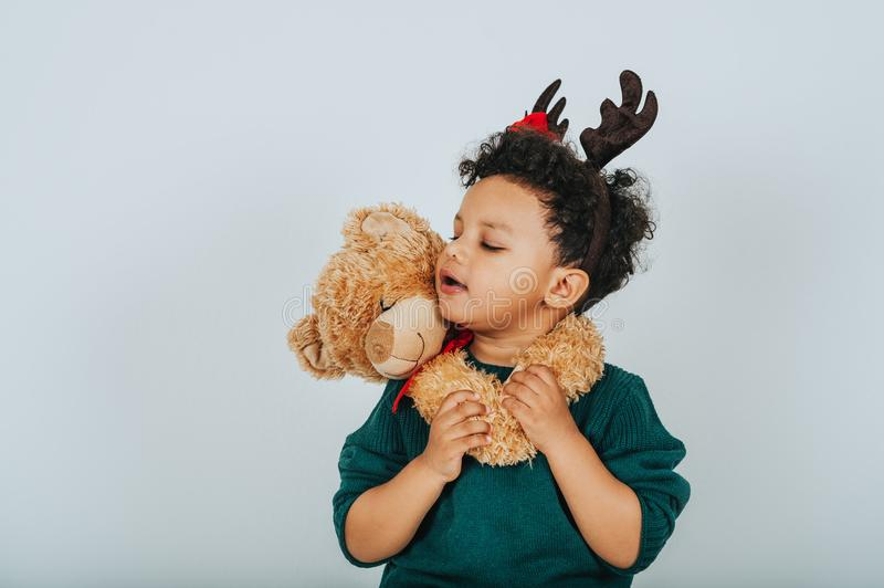 Christmas portrait of adorable toddler boy stock photo