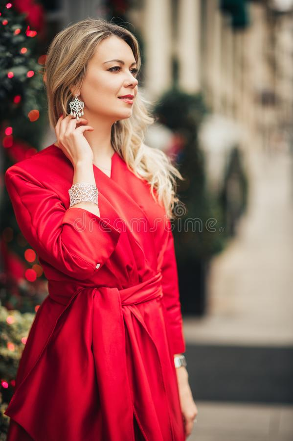 Christmas portrait of beautiful woman with blond hair royalty free stock photography