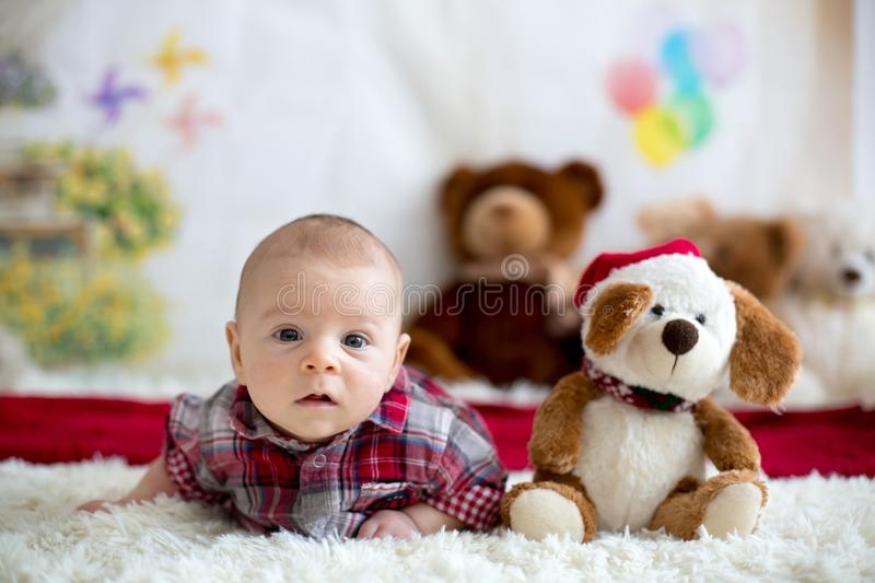 Christmas portrait of cute little newborn baby boy, dressed in c stock images