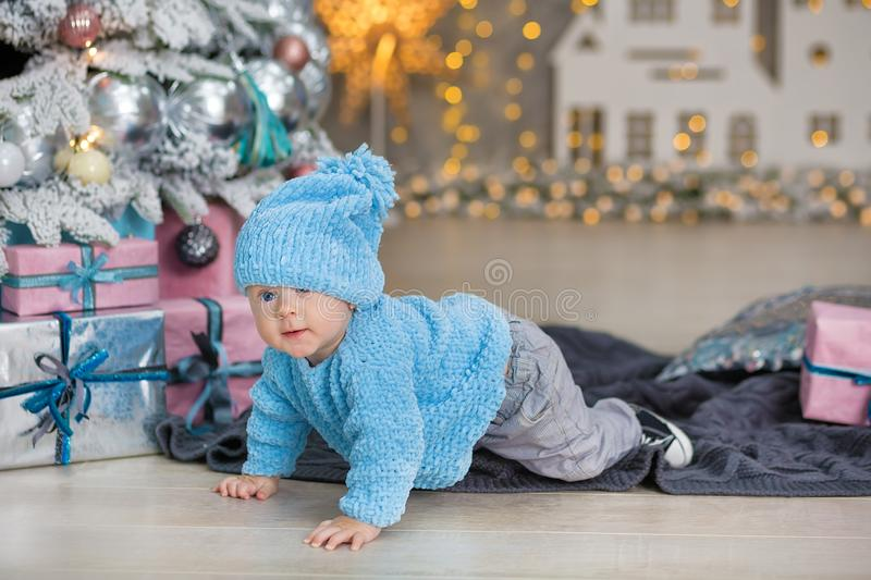 Christmas portrait of cute little newborn baby boy, dressed in christmas clothes and wearing santa hat, studio shot, winter time royalty free stock photo