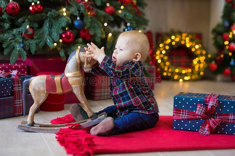 Christmas portrait of cute little newborn baby boy, dressed in christmas clothes and wearing santa hat, studio shot, winter time royalty free stock photography