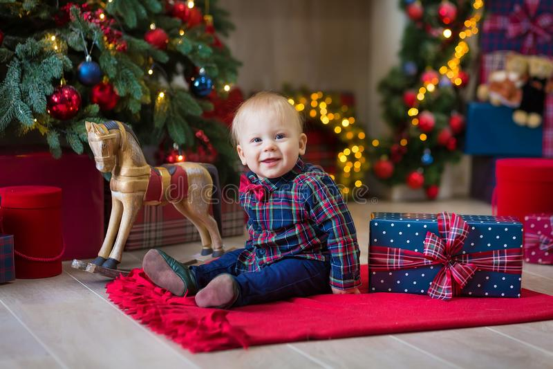 Christmas portrait of cute little newborn baby boy, dressed in christmas clothes and wearing santa hat, studio shot, winter time royalty free stock photos