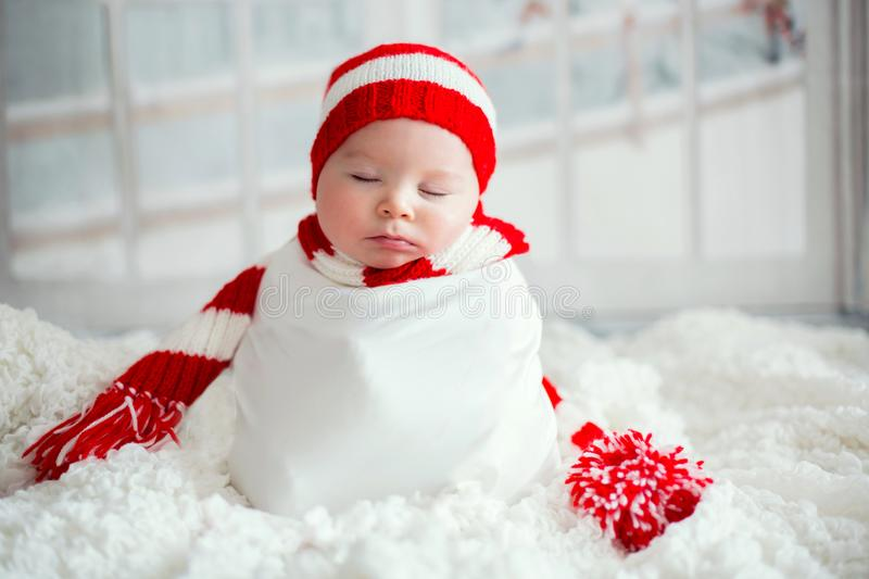 Christmas portrait of cute little newborn baby boy, wearing santa hat stock photos