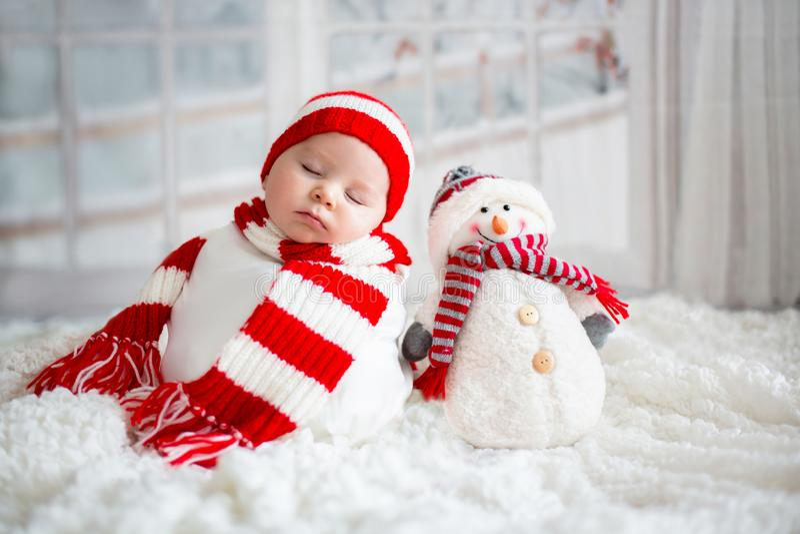 Christmas portrait of cute little newborn baby boy, wearing santa hat stock photo