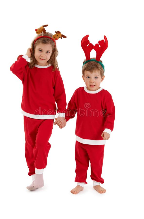 Christmas portrait of cute siblings royalty free stock images
