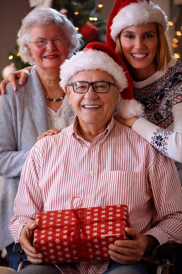 Christmas portrait - family with wearing Santa caps. Christmas portrait - smiling family with wearing Santa caps stock image