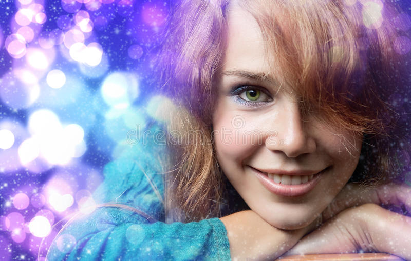 Christmas portrait of happy cute woman. Colorful Christmas portrait of happy cute young woman royalty free stock photography