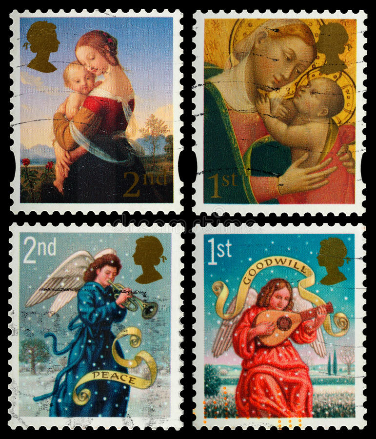 Christmas Postage Stamps. British Used Postage Stamps showing Madonna and Child and Angels royalty free stock photo
