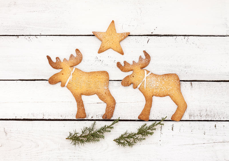 Christmas postcard or poster design with reindeer cookies stock photography