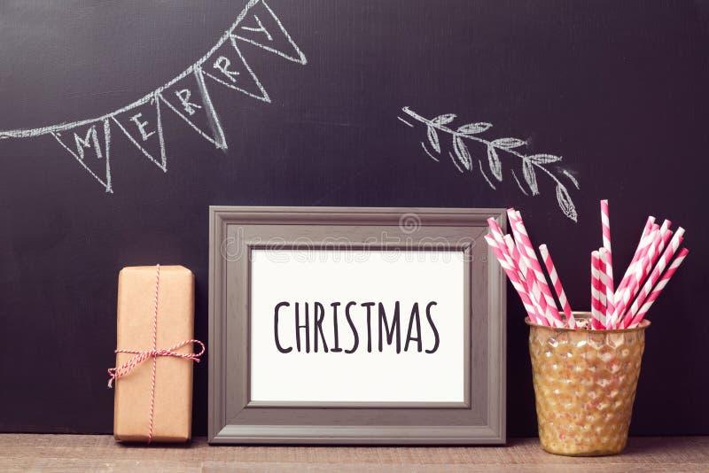 Christmas poster mock up template over chalkboard background. Christmas celebration poster mock up template over chalkboard background stock image