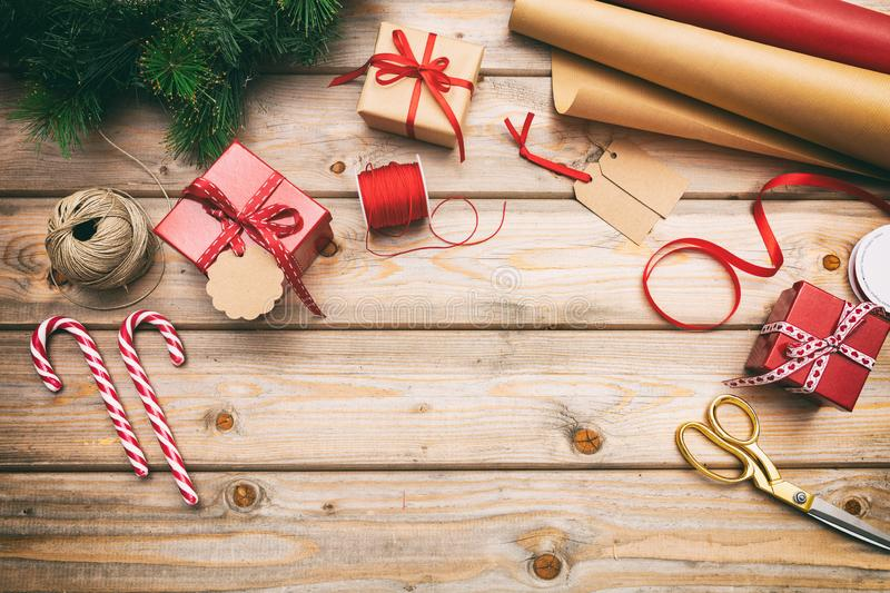 Christmas gift boxes wrapping on wooden background, copy space, top view royalty free stock image