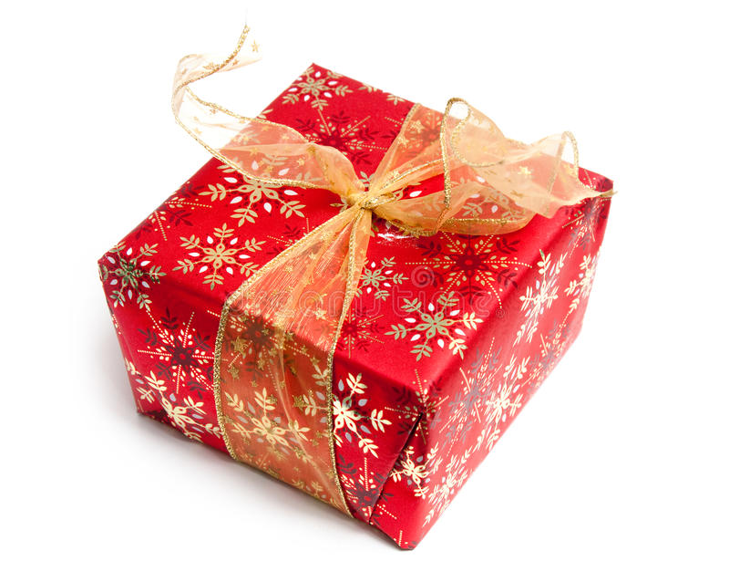 Christmas Present. Red Christmas present wrapped in gold snowflake paper with gold ribbon / bow