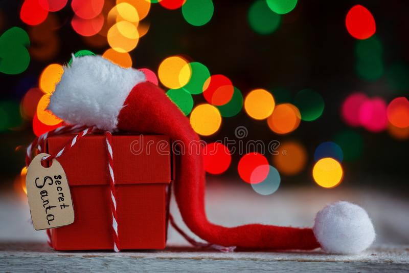 Christmas present or box for secret santa with Santa hat. Greeting card. stock photography