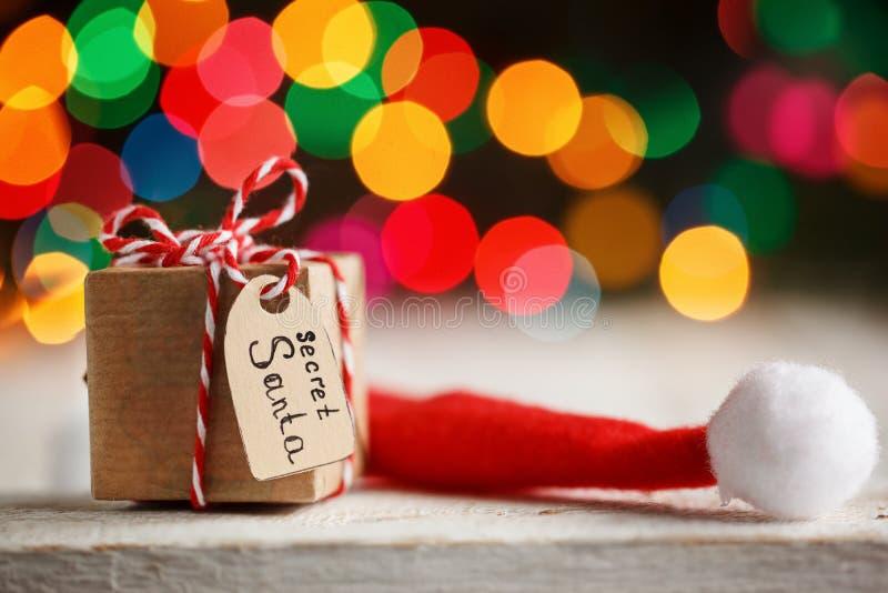 Christmas present or box for secret santa with Santa hat. Greeting card. stock image