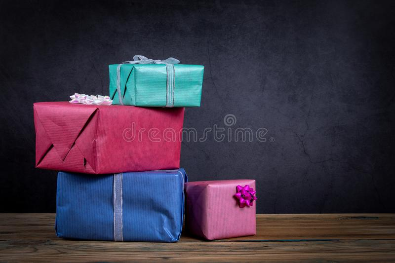 Christmas present boxes on a dark background royalty free stock photos