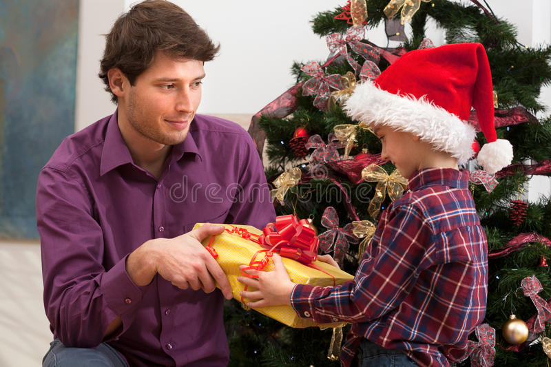 Christmas present form older brother stock photography