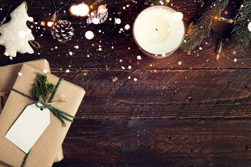 Christmas present gifts box and rustic decoration on vintage wooden background with snowflake. royalty free stock photo