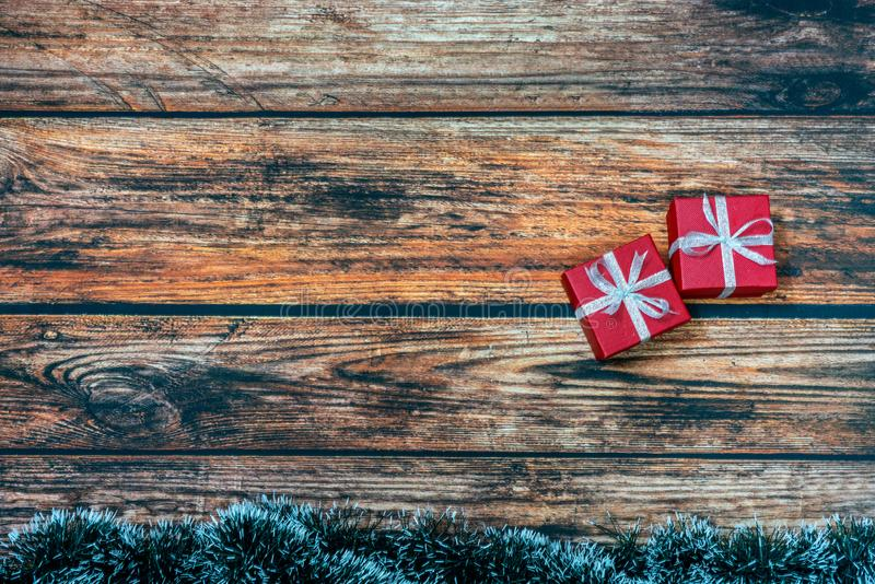 Christmas Present wrapped in red paper on a wooden background royalty free stock image