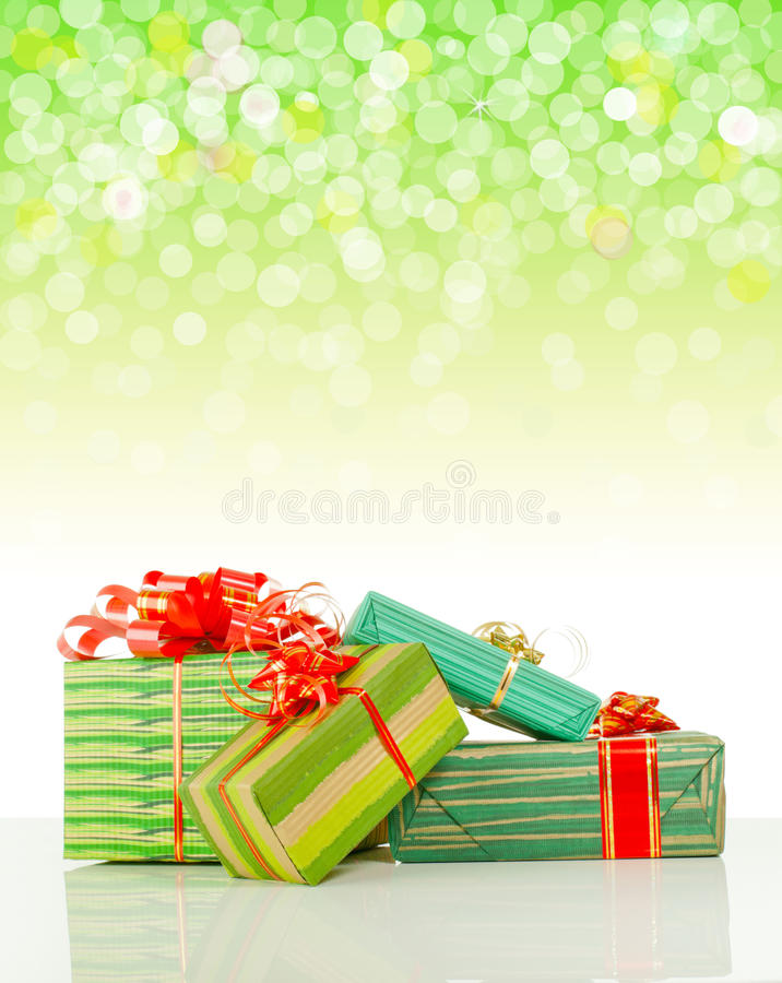 Christmas presents against bokeh background stock image