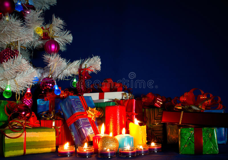 Christmas presents and burning candles royalty free stock photos