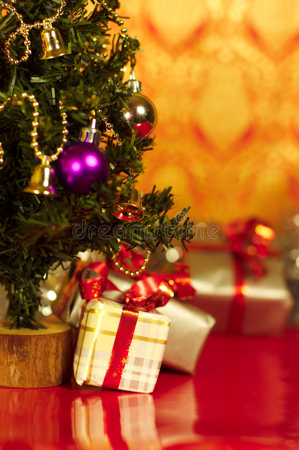Christmas Tree And Presents Gifts Under On Red Background Vertical Picture