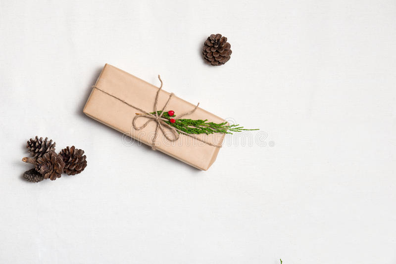 Christmas presents. Hand crafted xmas gift on table. stock photo