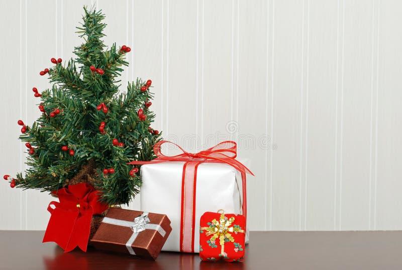 Christmas presents with mini tree royalty free stock photo