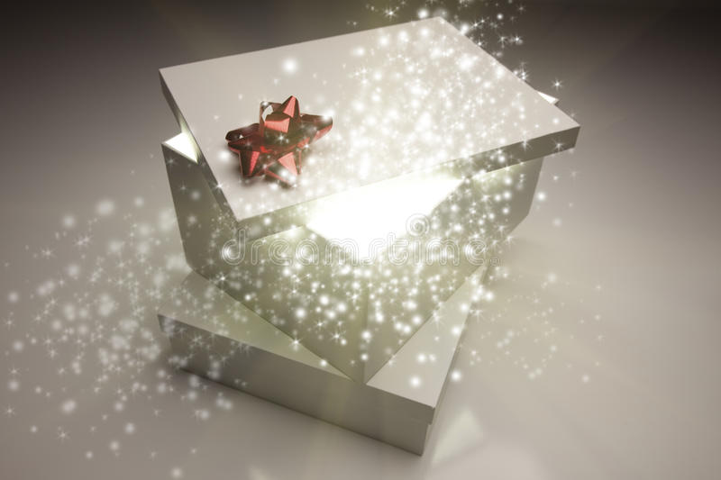 Christmas Presents With Something Bright and Magical Coming From stock image