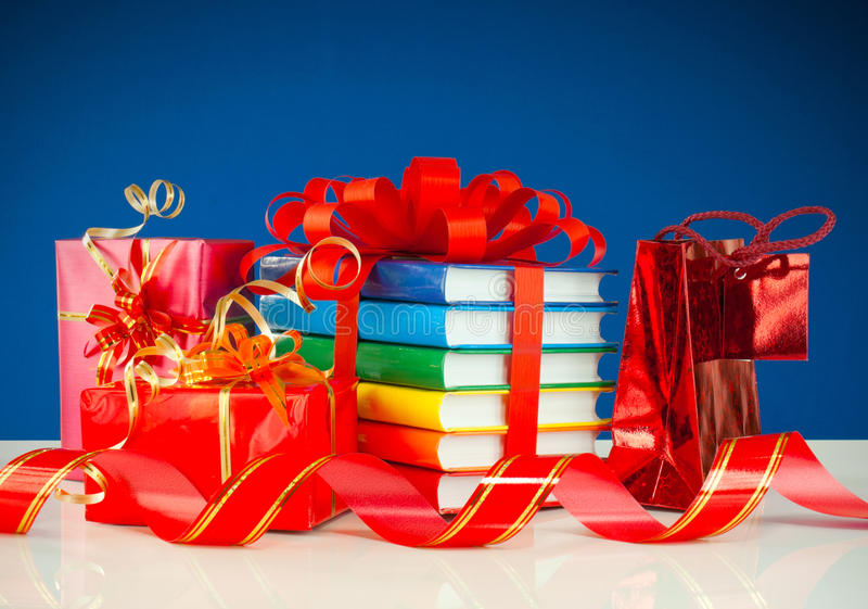Christmas presents with stack of books royalty free stock photos