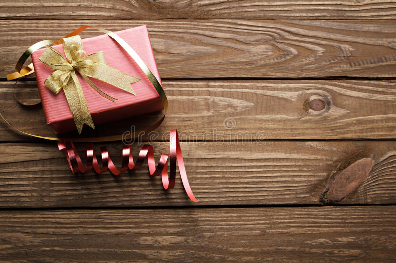 Christmas presents on wooden table background. Christmas presents on wooden table background royalty free stock image