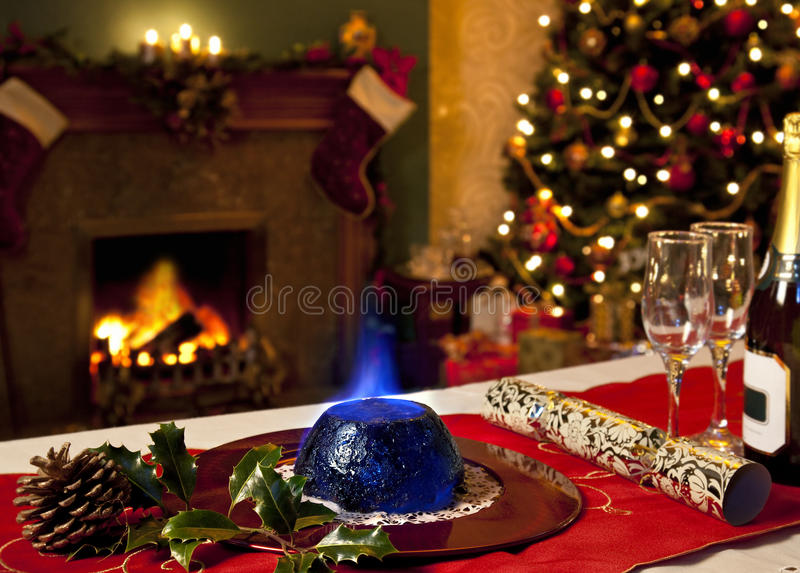 Christmas Pudding and Festive Fireplace royalty free stock image