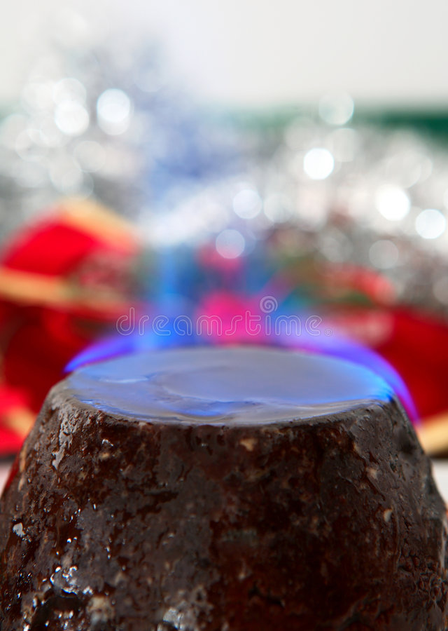 Christmas pudding with flame stock images