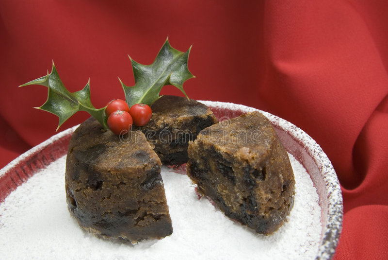 Christmas pudding with holly stock images