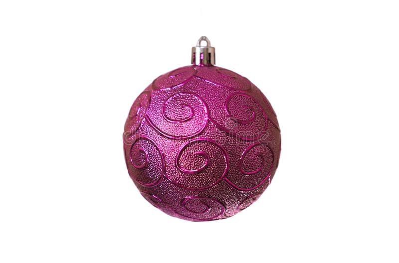 Christmas purple toy with spiral patterns for decoration on a white background, isolated, soft focus. Tree, celebration, holiday, winter, december, season royalty free stock photography
