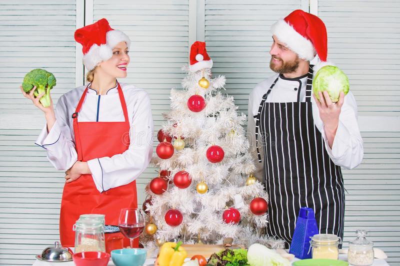 Christmas recipe concept. Secret ingredient is love. Couple preparing healthy meal together for christmas dinner stock image