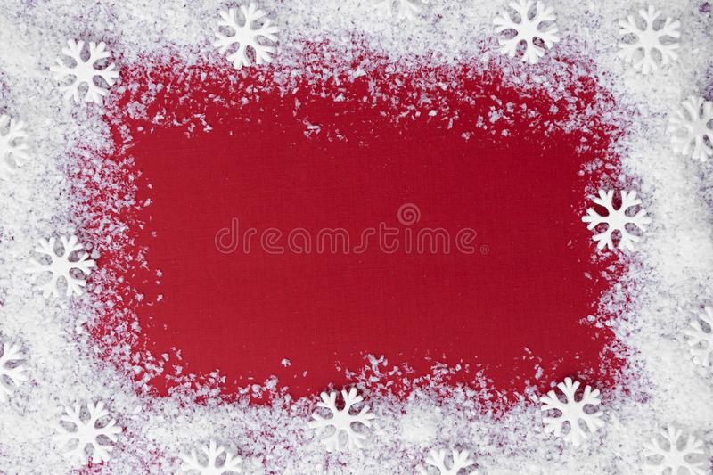 Christmas red background with snow and snowflakes frame. Winter, festive holiday mock up, copy space. Abstract red christams. Christmas red background with snow royalty free stock images