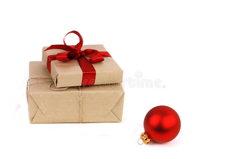 Christmas red ball and gifts boxes in kraft paper stock photos