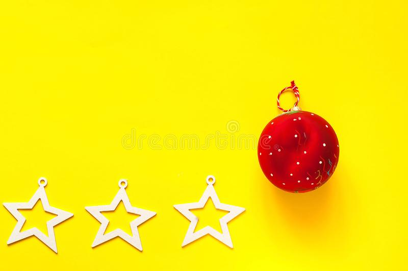 Christmas red ball on yellow background. The concept of the Chinese New Year. Festive backdrop for package and projects. royalty free stock photos