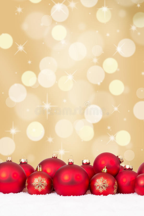 Christmas red balls decoration with golden background. Copyspace and snow royalty free stock photos