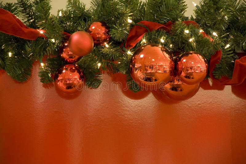 Christmas red balls lights tree background. Christmas decoration with red balls, lights, ribbon tree and red background royalty free stock photo