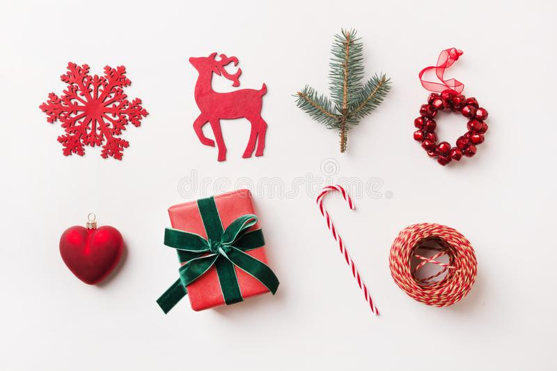 Christmas red collection with balls, snowflakes, heart, reindeer, candy cane, wreath for mock up. Template, design. Flat lay. View stock photos