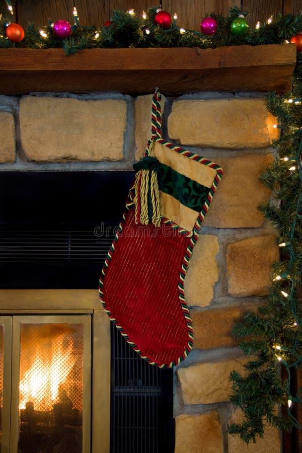 Christmas Red Corduroy Stocking Hanging on Fireplace royalty free stock image