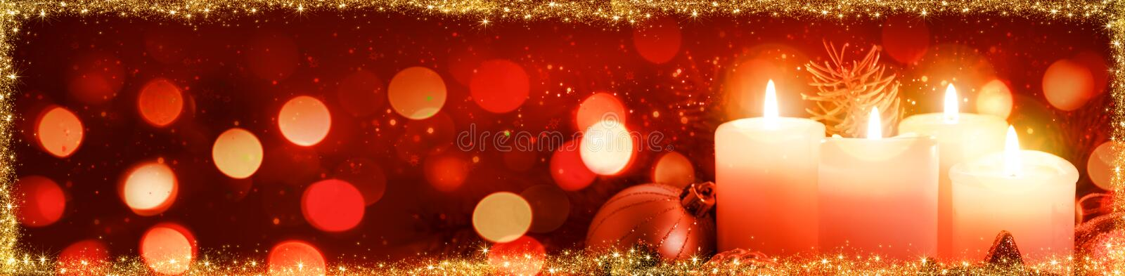 Four burning Advent candles and decoration. . Christmas background. royalty free stock photography