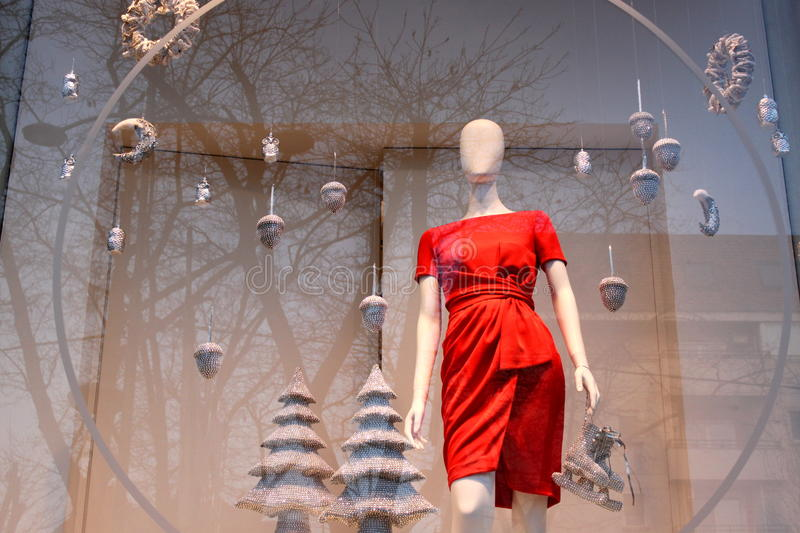 Christmas red dress. Red dress seasonal by Christmas and decoration and and reflection in the window of a tree royalty free stock photography
