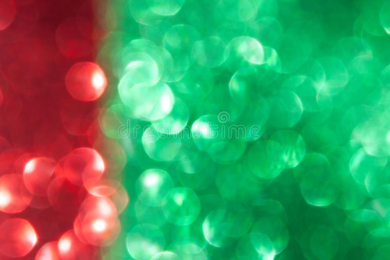 Christmas red and green background. Christmas red and green abstract bokeh background, defocused Christmas lights. Festive concept. Selective focus stock photos