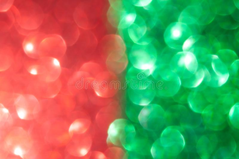 Christmas red and green background. Christmas red and green abstract bokeh background, defocused Christmas lights. Festive concept. Selective focus stock photography