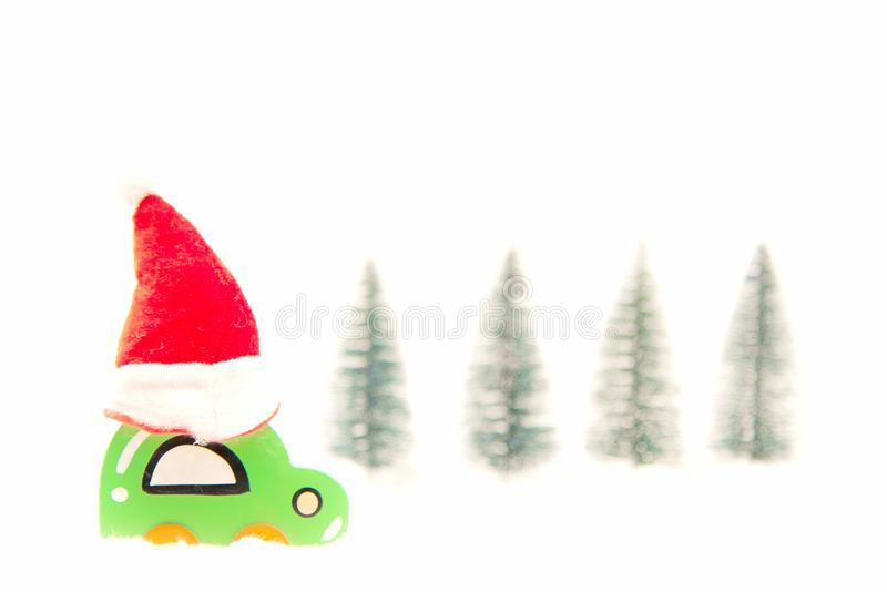 Christmas red hat on wood toy car on the snow. Christmas holiday. Celebration concept royalty free stock image