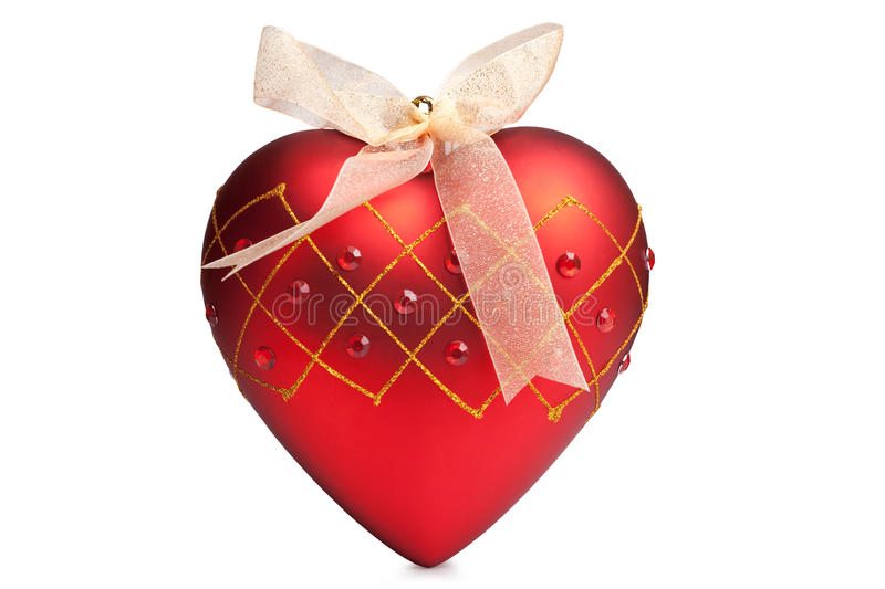 Christmas red heart. Christmas red ball in a form of heart royalty free stock images