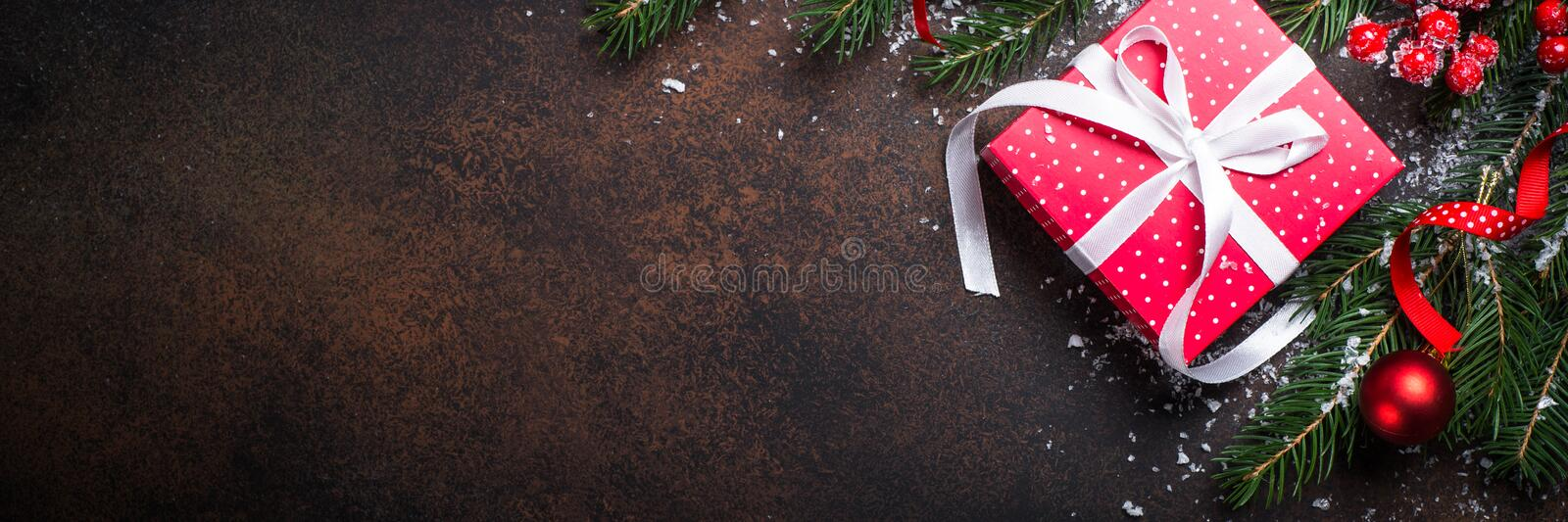 Christmas red present box on dark background. royalty free stock images