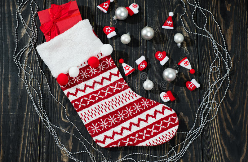 Christmas red sock on a wooden background royalty free stock image